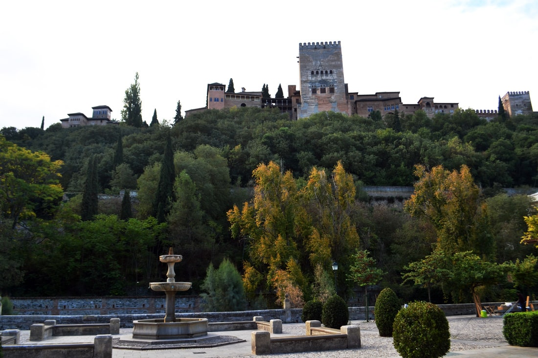 Photo of the Alhambra in Granada Spain from below. Read about the best things to do in Andalucia Spain!