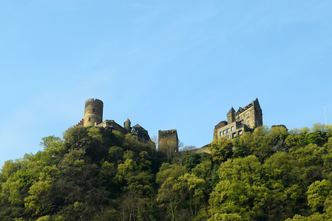 Visit the Rhine Valley wine region in Germany on a budget, including staying IN a castle, which Rhine Valley castles to visit, which towns to explore, and taste the famous wine. All without a river cruise!