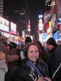 Photo of girl in Times Square on New Year's Eve. Read tips for going to Times Square on New Year's Eve.