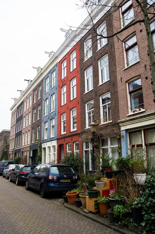 Beautiful houses of De Pijp, one of the most instagrammable places in Amsterdam. Read insider tips for the best places to take photos in Amsterdam! #amsterdam #travel #photography