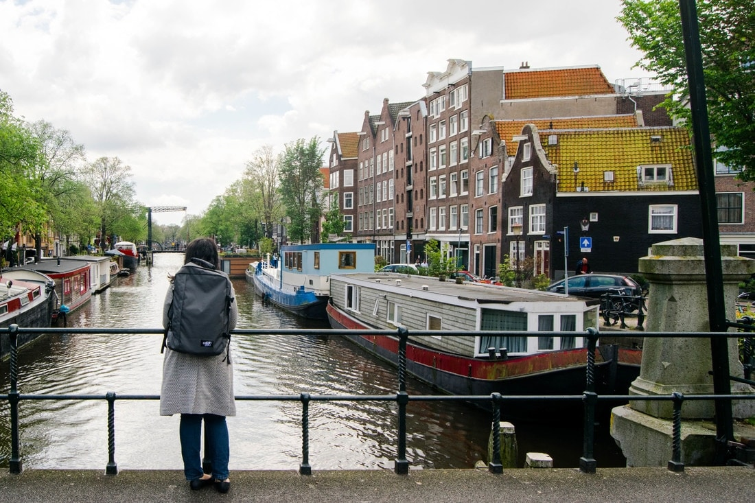 Woman wearing a travel backpack in Amsterdam