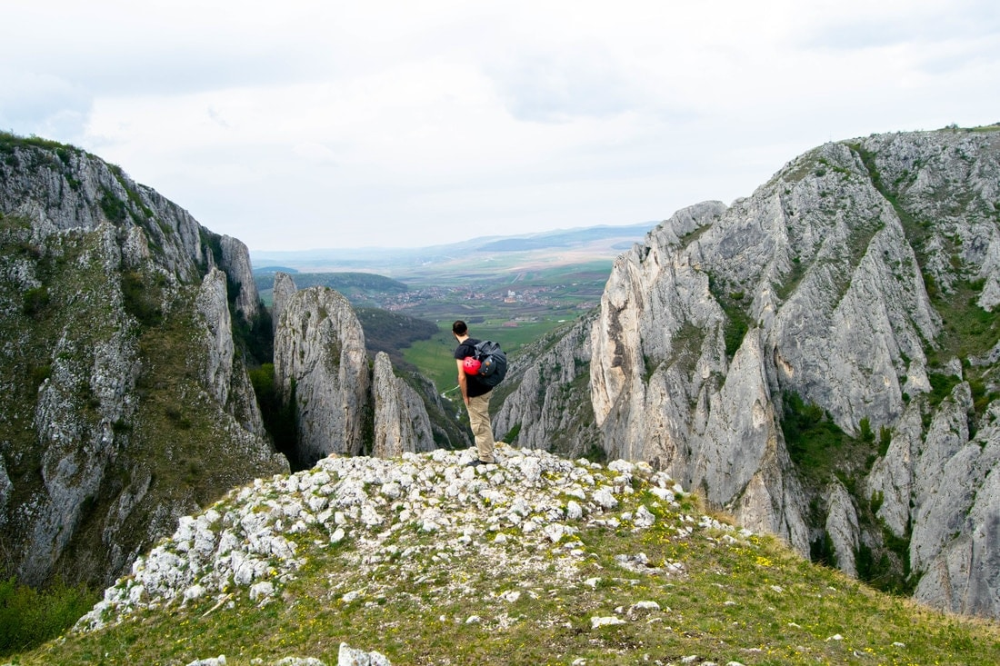 Man admiring the view in Romania, one of the best places to go hiking.