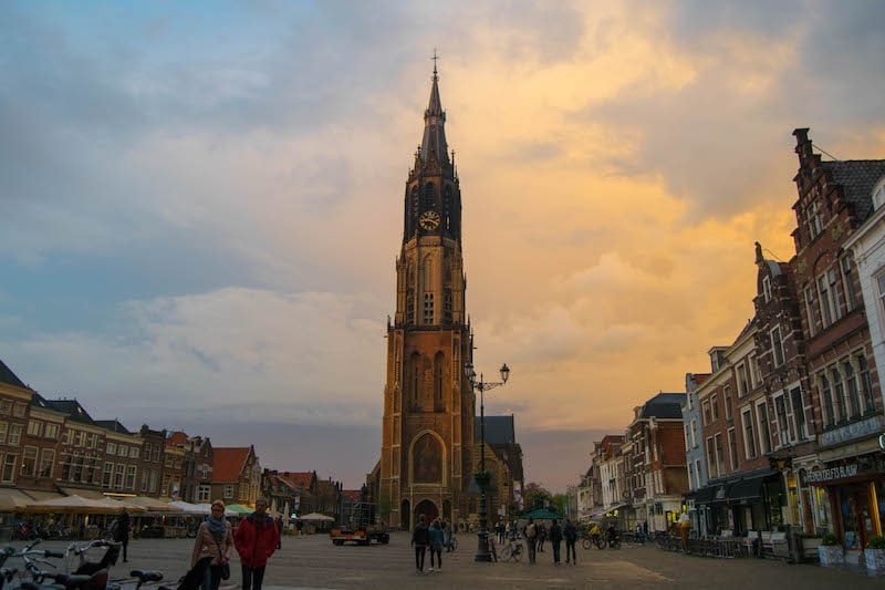 Photo of Delft at sunset. Perfect day trip around amsterdam and one of the most beautiful places to visit in the netherlands