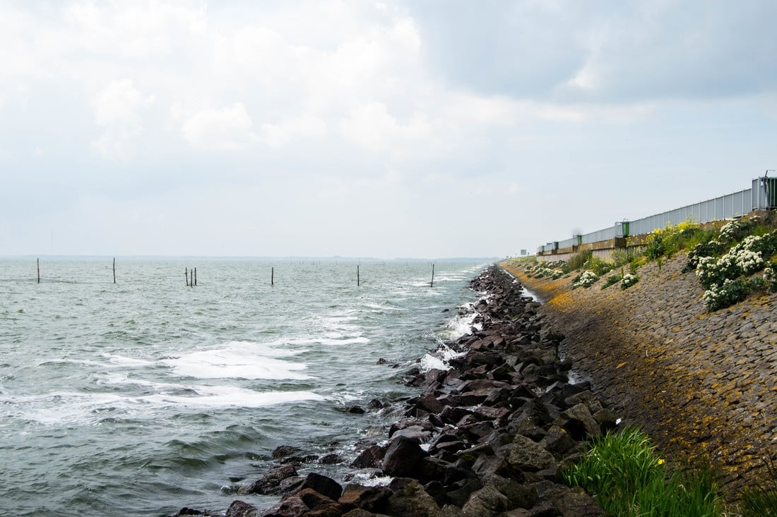 Photo of Afsluitdijk, the sea barrier in the Netherlands. This dijk was built to close off the Netherlands from the sea.