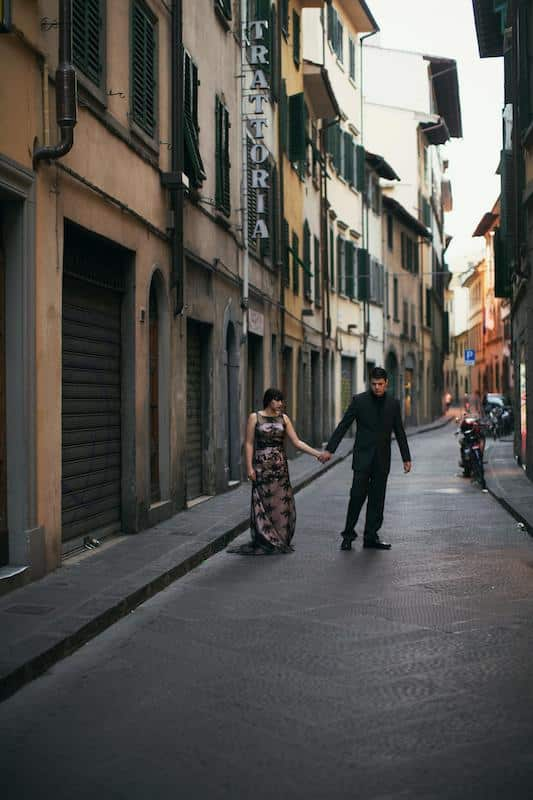 Old world charm. Couple holding hands on streets of Florence in Italy from an elopement in Italy.