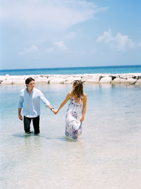 Photo of couple holding hands in water from elopement in Montego Bay.