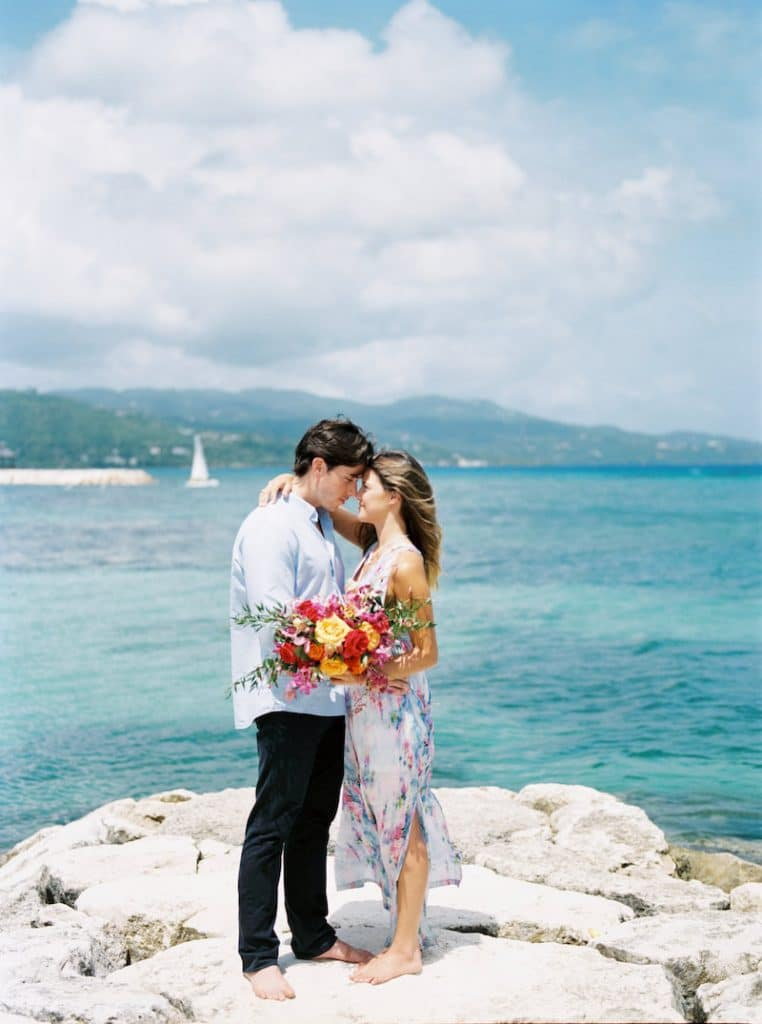 Photo of couple eloping in Jamaica. More elopement photo inspiration with the 15 best places to elope!