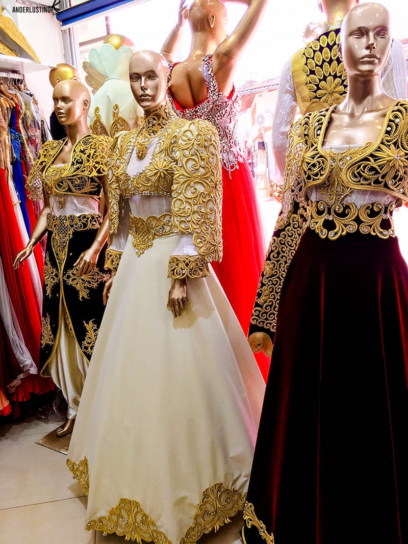 Traditional Albanian dresses in the Bazaar of Peja. Find out about the best cities to visit in Kosovo!
