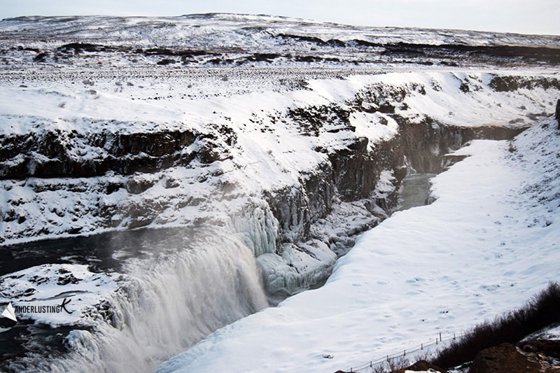 Photo of frozen waterfall in Iceland in winter. Read more about driving Ring Road in winter.
