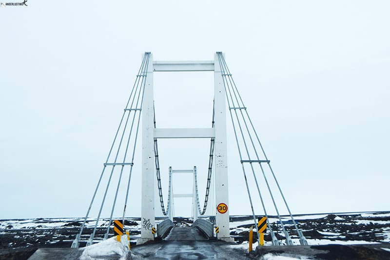 Photo of one lane bridge in Iceland. Find out driving tips for driving in Iceland for your road trip in Iceland.