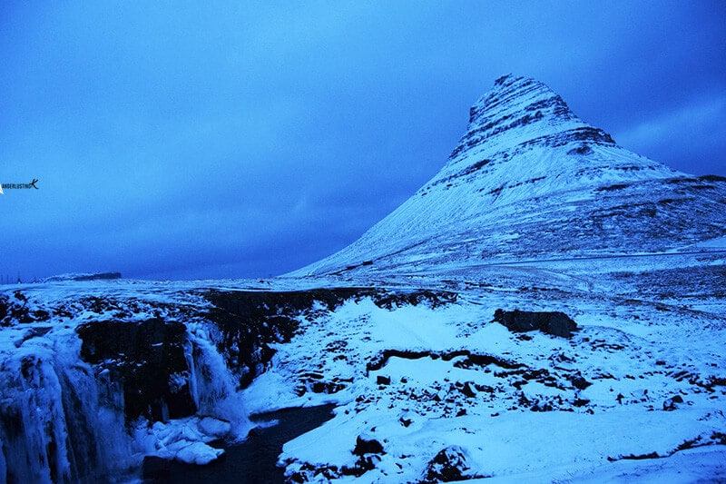 Photo of Kirkjufell in Iceland. Read Iceland tips for visiting Iceland in December and a complete road trip around Iceland.