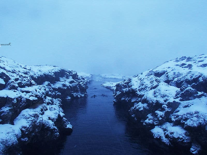 Phot of Silfra fissure in Iceland. Find out the best road trip in Iceland in winter.