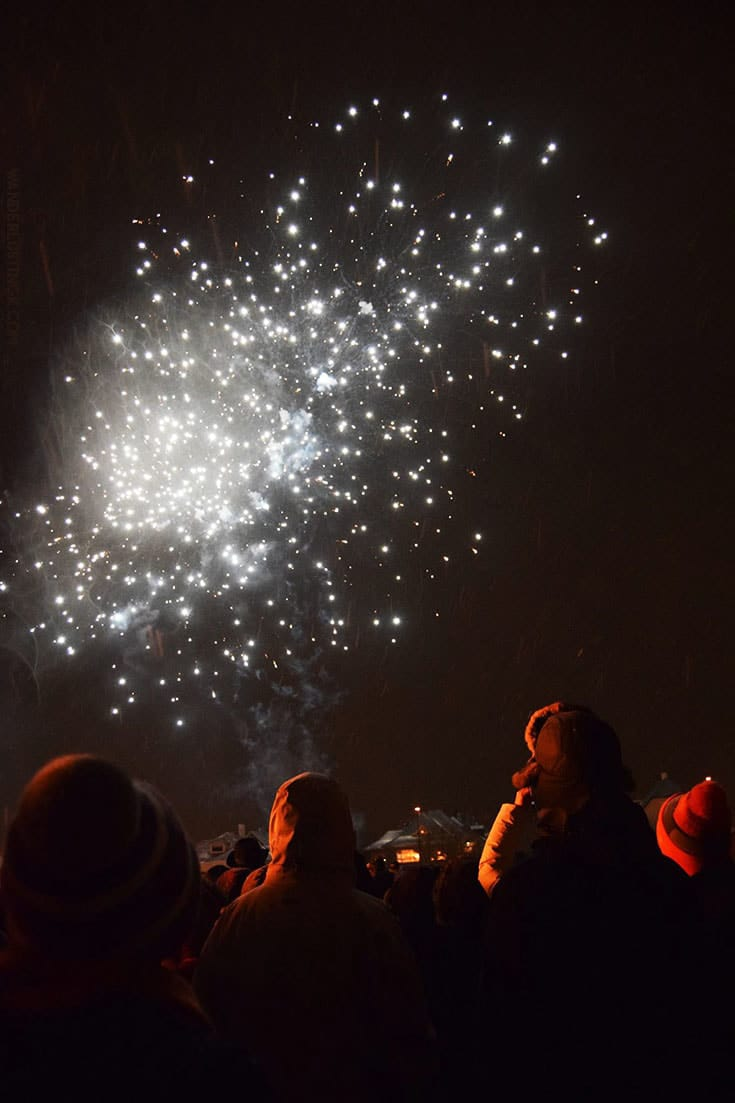 Photo of people watching fireworks at bonfire in Reykjavik Iceland. Find out the best things to do on New Year's Eve in Iceland. #NewYearsEve #Iceland
