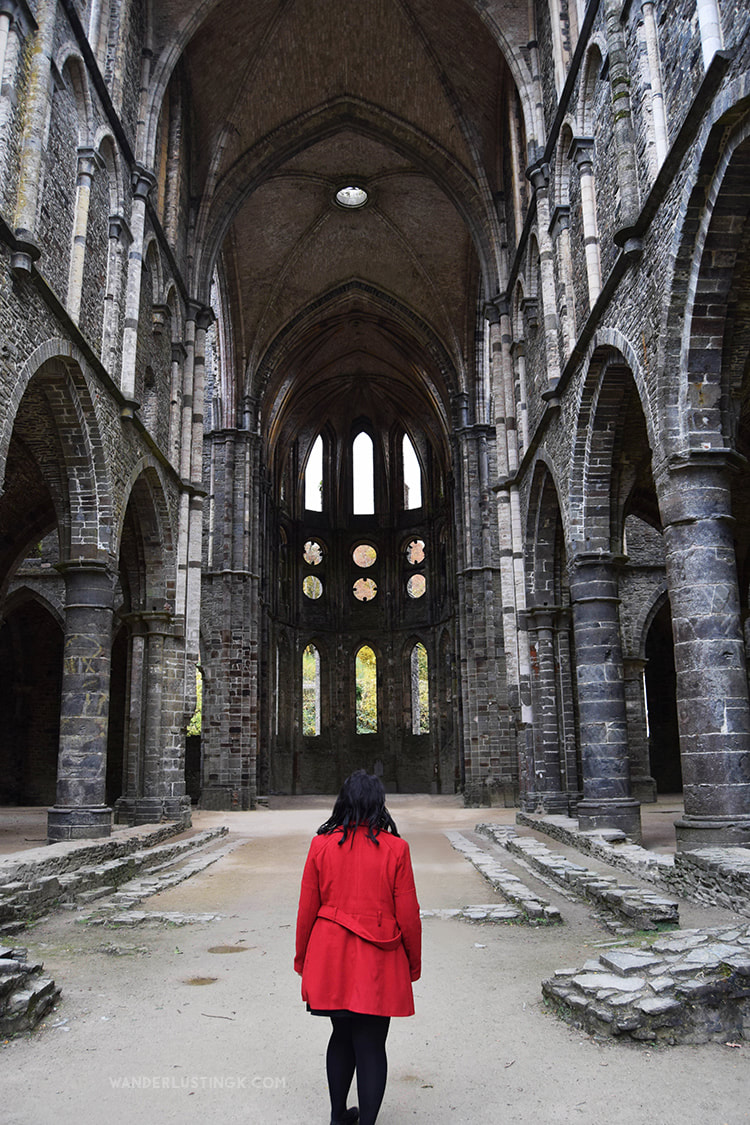 Girl in Abbey. Find out the best day trip from Brussels for architecture lovers and the most instagrammable place in Belgium! #Travel #Belgium