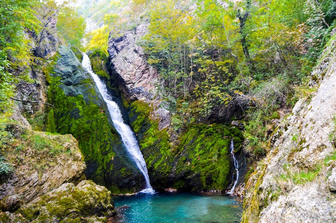 Beautiful waterfall with amazing blue water in Peja Kosovo. See why you should visit Kosovo via beautiful nature photographs.