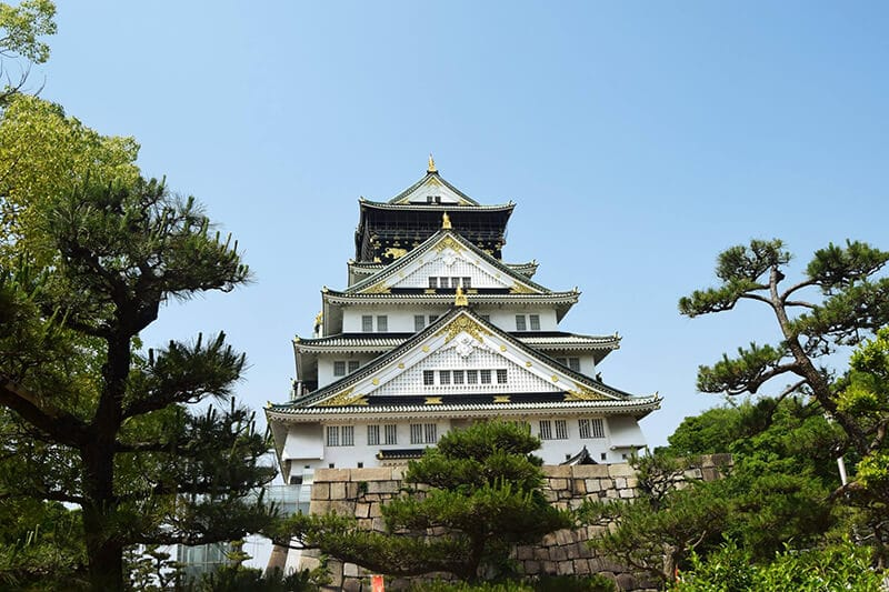 Castle in Osaka. Read how to have a cheap trip to Japan with money saving tips for visiting Japan on a budget.