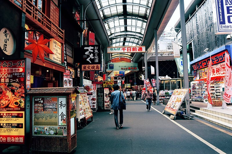 Street in Osaka. Read budget travel tips for Japan and how to save money before your trip to Japan!