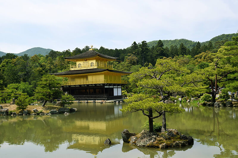 Golden Temple Kinkaku-ji Shrine in Kyoto. Read about how to visit Japan on a budget and whether if you should get the JR Pass to save money in Japan.