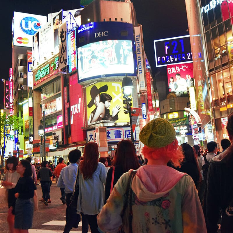 Shibuya Crossing in Tokyo, Japan. Read about the best ways to travel on a budget in Japan.