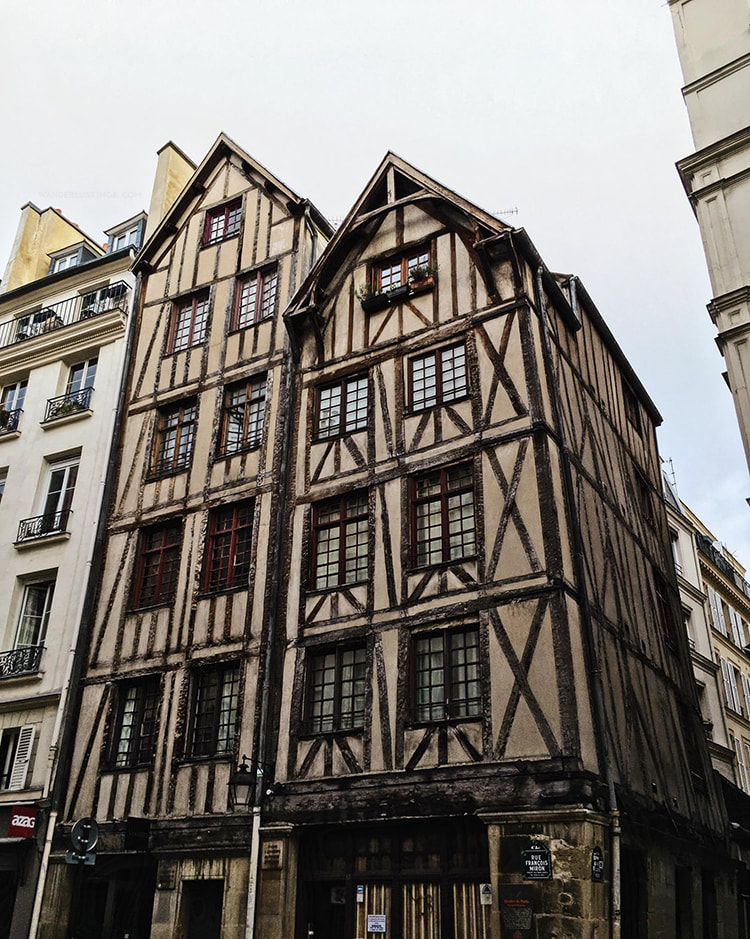 Beautiful building in the Marais Paris. Read a local's guide to Paris with insider tips for off the beaten path Paris on a budget. #Paris #France #Travel