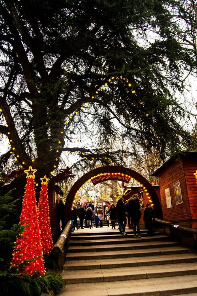 Entrance to the Stadtgarten Christmas Market in Cologne Germany. Read about the best Christmas markets in Cologne! #Cologne #Germany #Christmas