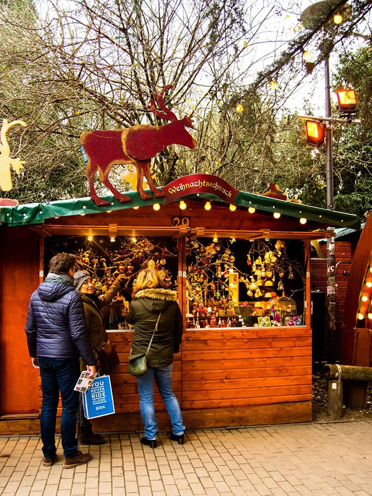 Stall in the Stadtgarten Christmas Market in Cologne. Read tips for visiting the German Christmas Markets in Cologne Germany.