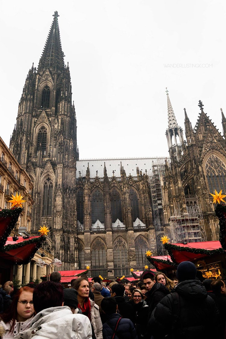 Cologne Christmas Market during the day. Read about the best things to do in Cologne in December with tips for visiting the Christmas Markets in Germany