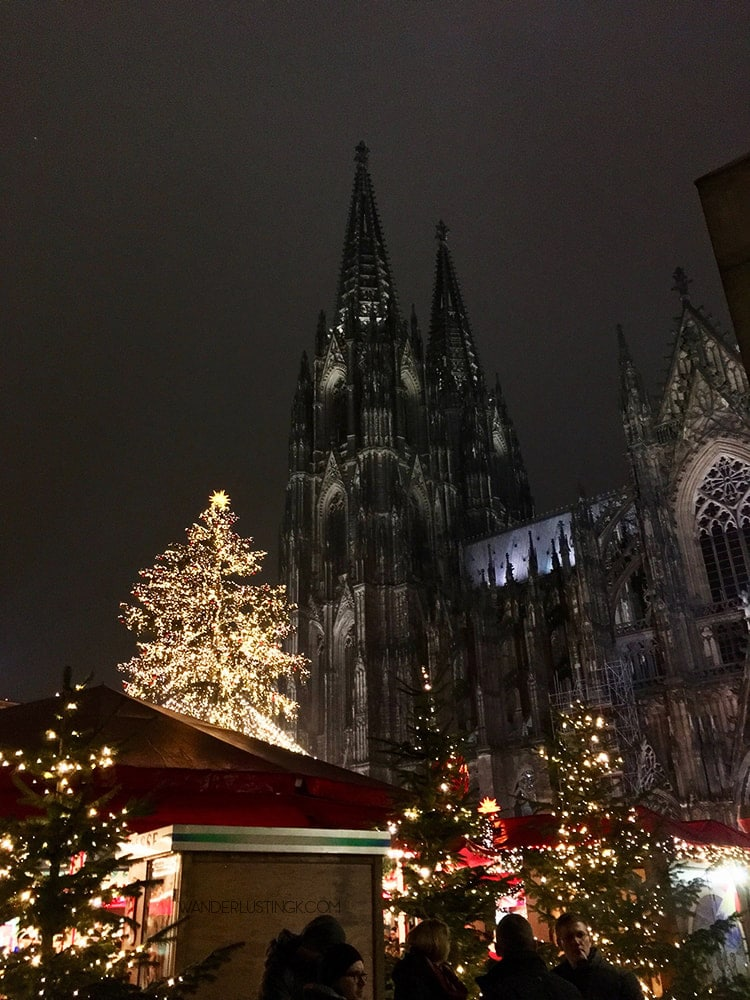 Photo of Cologne Cathedral during Christmas market. Find out the best things to do in Cologne in winter with map of Cologne Christmas Markets!