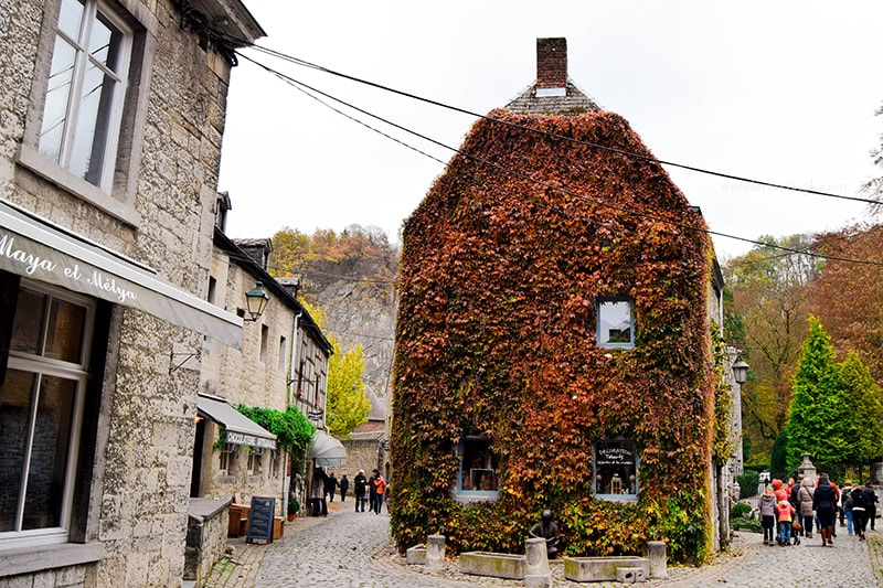 Beautiful vine covered building in Durbuy. Visit Wallonia in fall for beautiful foliage in Belgium!
