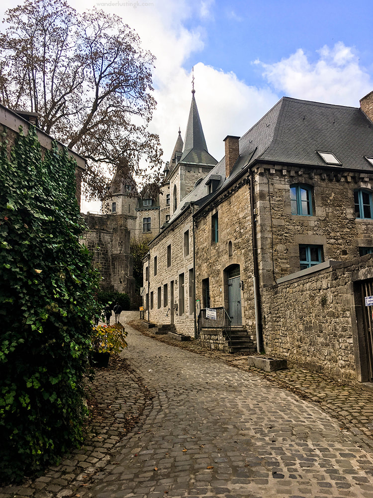 Beautiful cobblestone street in Durbuy Belgium. Discover reasons to visit this beautiful Belgian city! #Belgium #Durbuy #Travel