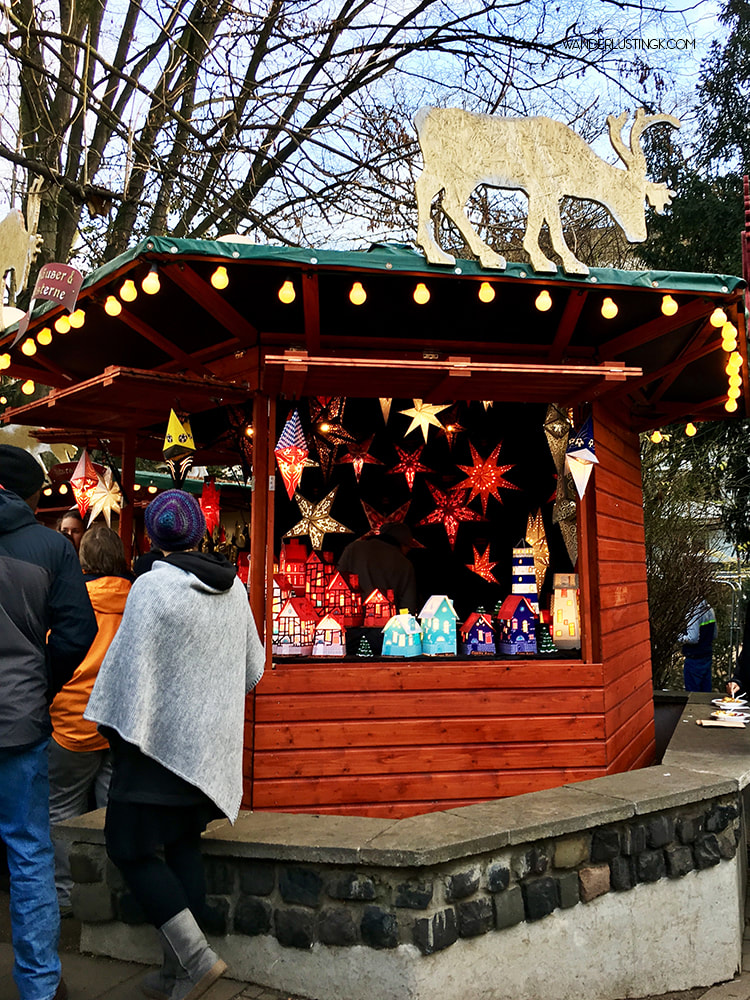 Decorated Christmas Market Stall in Cologne Germany. Get a free map of the Cologne Christmas Markets with a walking tour! #Cologne #Christmas #Germany