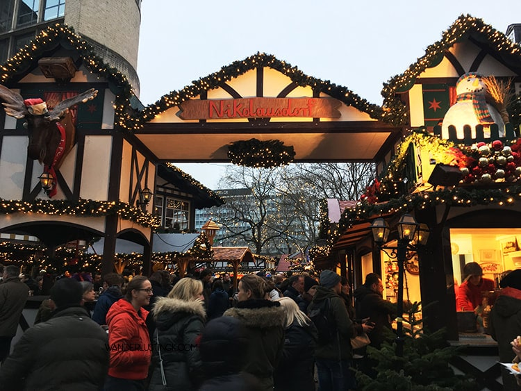 Read about the best Christmas markets in Koln Germany. Photo of Rudolfplatz Christmas Market.