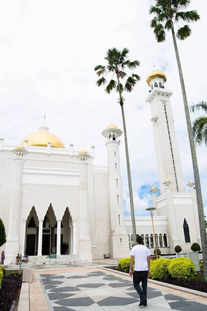 Photo of man walking towards mosque in Brunei. Read more tips on things to know about Brunei and tips for travel in Brunei. #Brunei #Travel #Asia