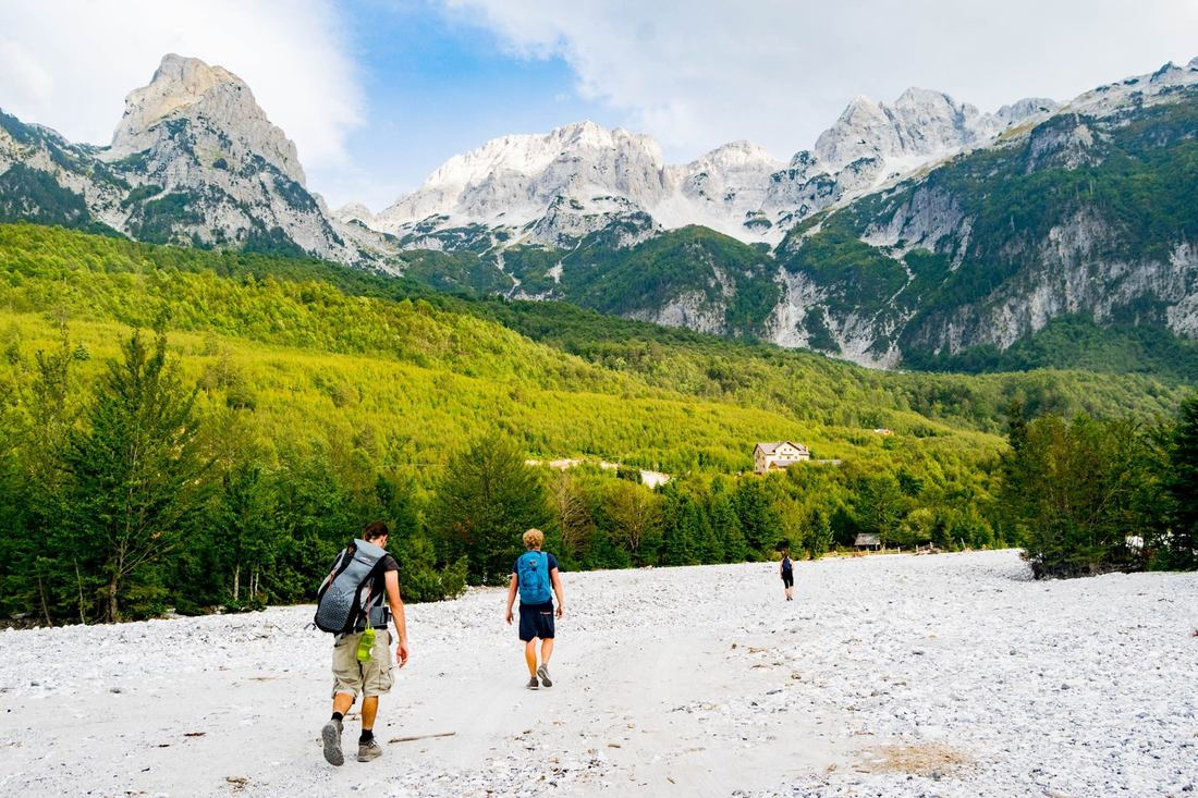 Photo of hikers in Valbona Peak National Park in Albania, one of the most beautiful places in Albania.