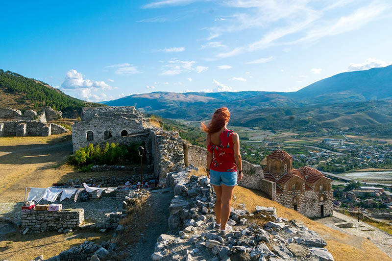 Beautiful photo of girl enjoying view from Berat castle in Berat Albania. Foto e bukur e vajzës që shijon pamjen nga kështjella e Beratit në Berat të Shqipërisë.