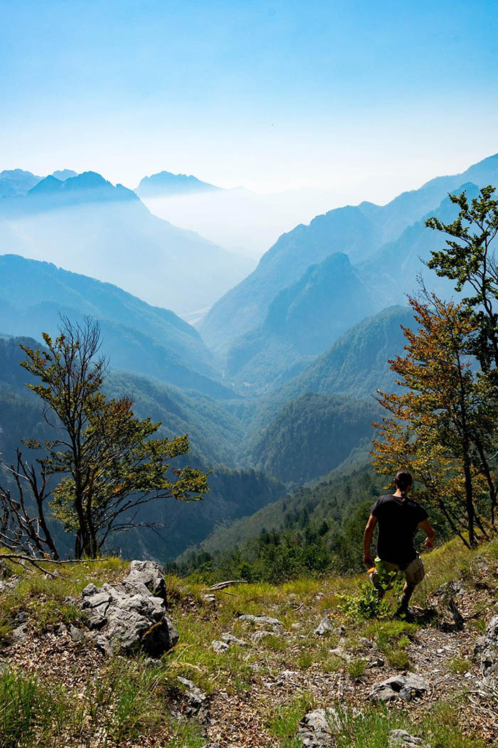 Photo of man hiking in Theth National Park in Albania. See why you should visit Albania with beautiful photos of Albania! #Albania #Travel #Balkans