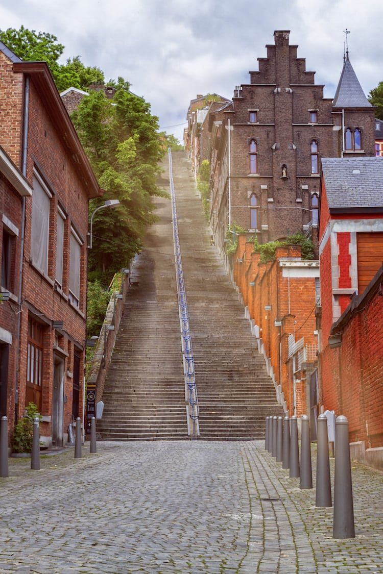 Photo of the Montagne de Bueren in Liege Belgium. Read about the most beautiful places to visit in Belgium's Wallonia region. #Travel #Belgium #Wallonia