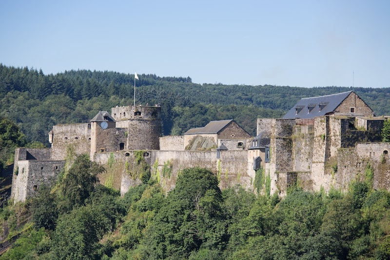 Photo of castle in Bouillon. See why you should visit Wallonia to see the most beautiful cities in Belgium by visiting Wallonia!