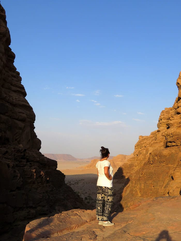 Photo of female tourist in Wadi Rum desert in Jordan. Read what to wear in the Middle East for female travelers with tips for appropriate clothing in the Middle East for women. #Travel #Fashion #MiddleEast