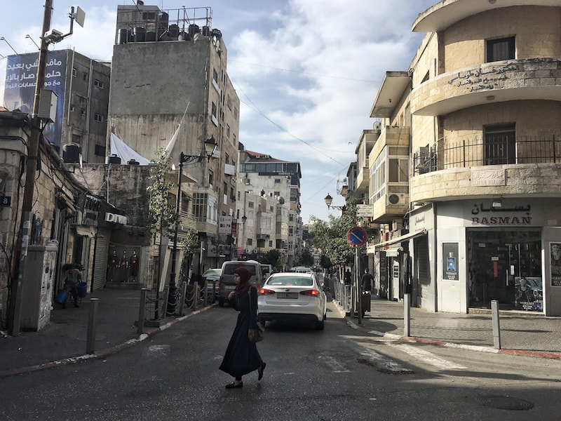 Photo of street scene in Palestine. Read what to wear in Palestine for women and appropriate clothing for women in the Middle East.