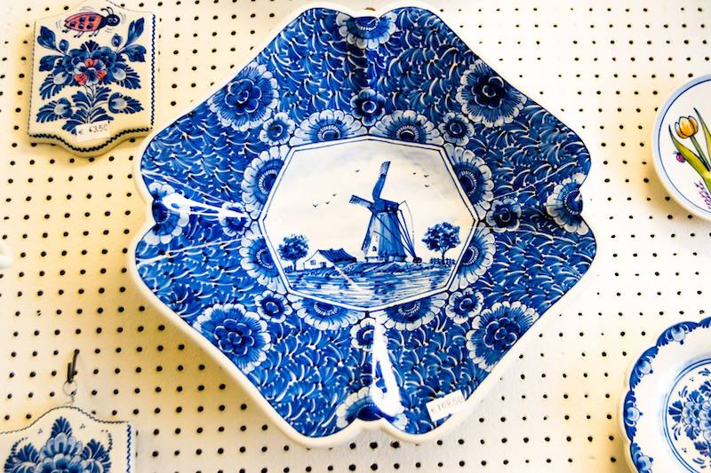 Photo of delftware in Delft. When visiting Delft, be sure to stop off at the delftware stores in Grote Markt. Follow this FREE walking tour of Delft to get more insider tips on what to do in Delft and where to eat in Delft! #Delft