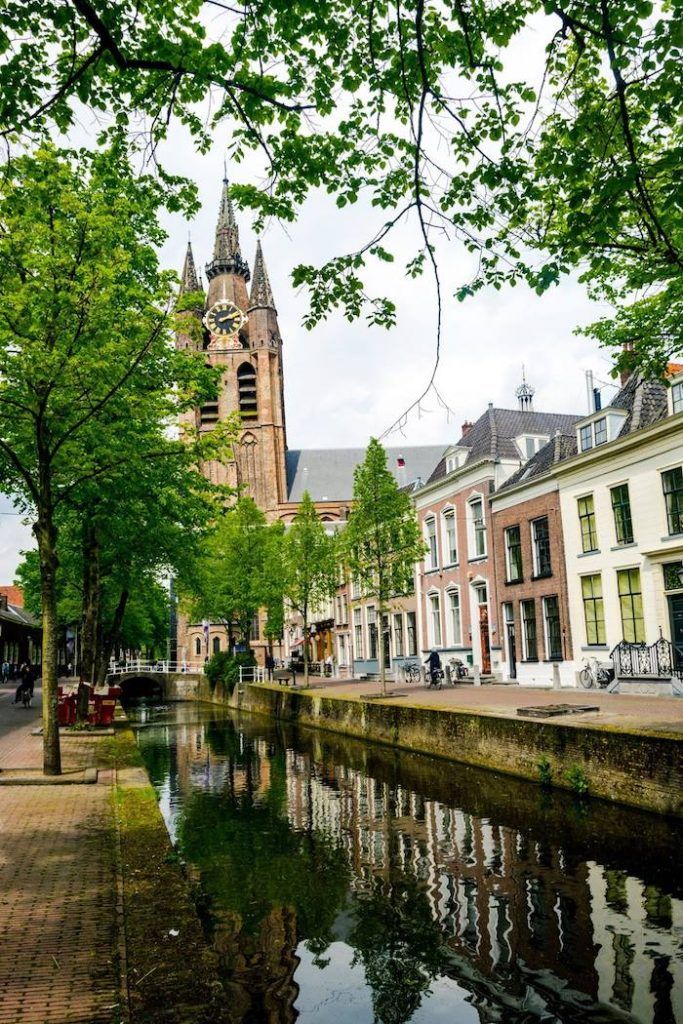 Photo of the (Oude Kerk) Old Church in Delft, a must-see in Delft. Follow this perfect one day Delft itinerary for the best things to do in Delft and the best places to eat in Delft. #Delft #Travel #Netherlands