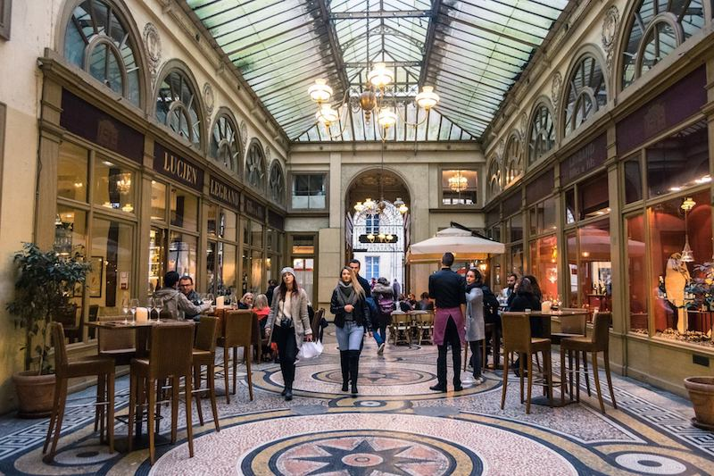 Photo of Galerie Vivienne, one of the most famous covered passages of Paris. A must see if you're looking for unusual things to do in Paris.