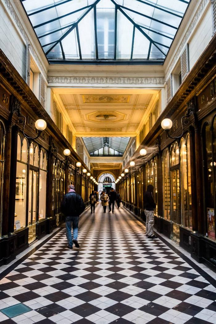 Photo of Galerie Véro-Dodat, one of the most beautiful galleries of Paris. See the historical arcades of Paris on foot for free with a free walking tour with map. #Paris #France #Travel