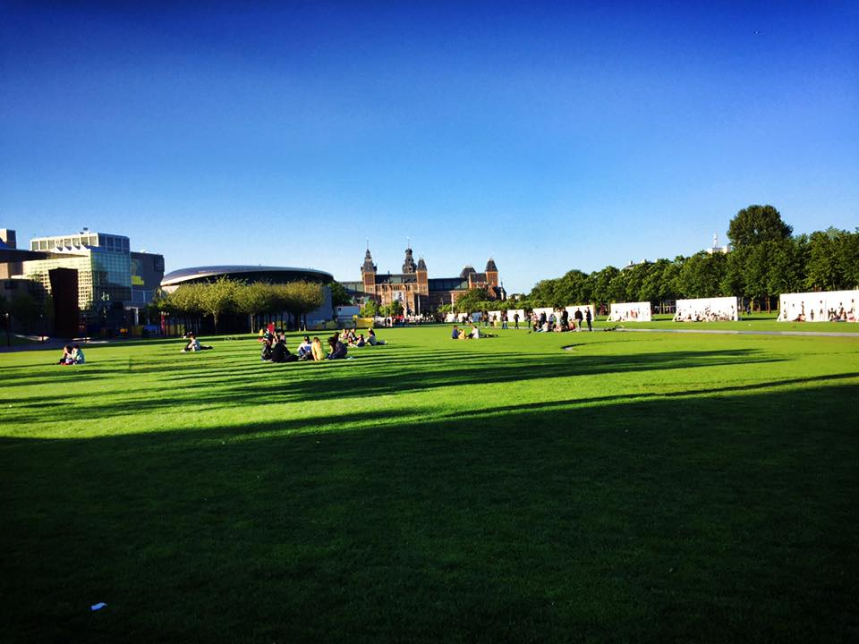 Photo of Museumplein in Amsterdam, one of the best places to visit in Amsterdam for free. Read more tips for visiting Amsterdam on a budget from a resident! #travel #europe #amsterdam #netherlands