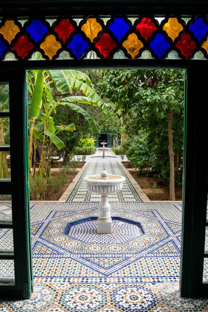 Photo of elaborate gardens in the Bahia Palace in Marrakech, Morocco. Read the best things to do in Marrakech over three days. #travel #Marrakech #Morocco