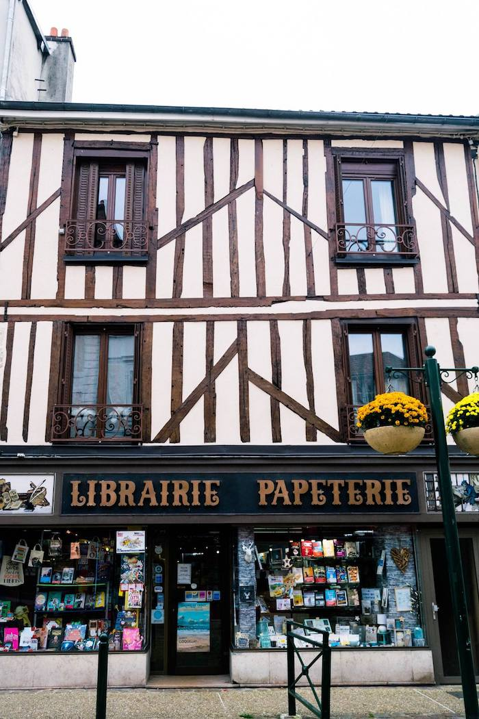 Photo of Librairie Delvaux, a beautiful bookstore in Provins France. This bookstore is in a UNESCO town only a day trip from Paris! #travel #France #Paris #UNESCO