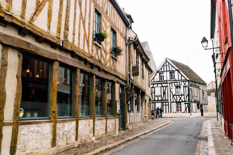 Photo of timbered houses in Provins France. Walking around the medieval city center is one of the best things to do Provins.