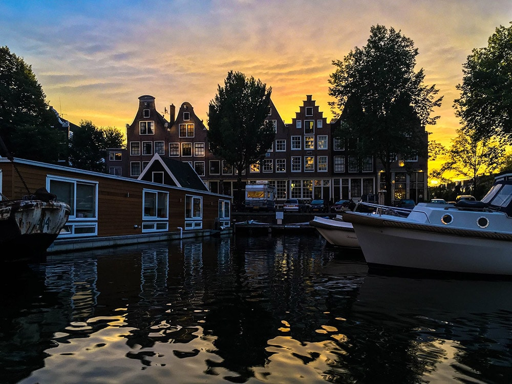 Photo of houses in Amsterdam. Read about the best books about Amsterdam, the Netherlands to read before your trip to Amsterdam!