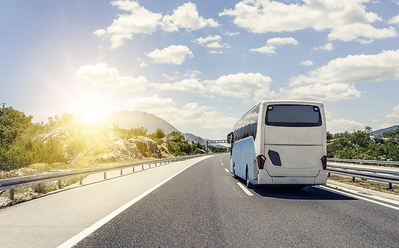 Bus traveling along highway in the United States. Must-know tips if you're considering traveling by bus in the US!